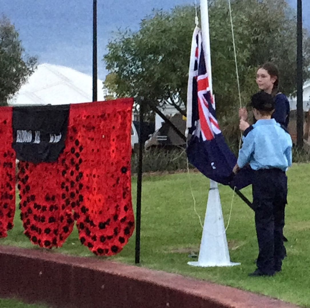 Lowering the flag at the ANZAC Day dawn service
