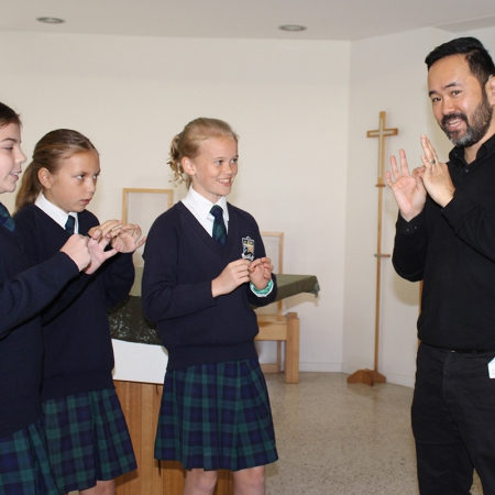 Access Plus WA Deaf representative teaching SVACS students simple sign language.