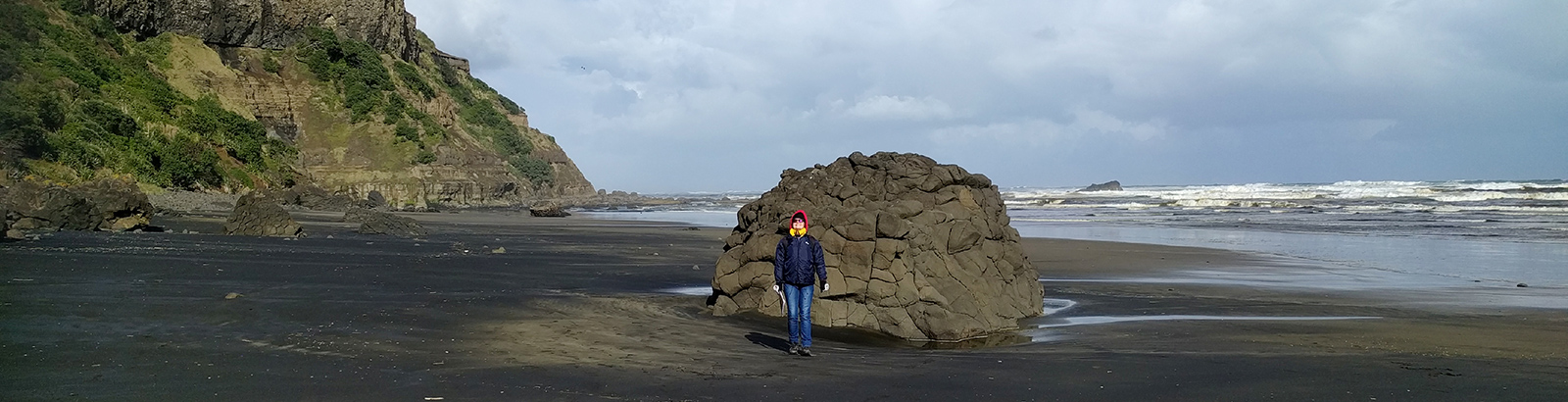 The black volcanic sand at Muriwai Beach.