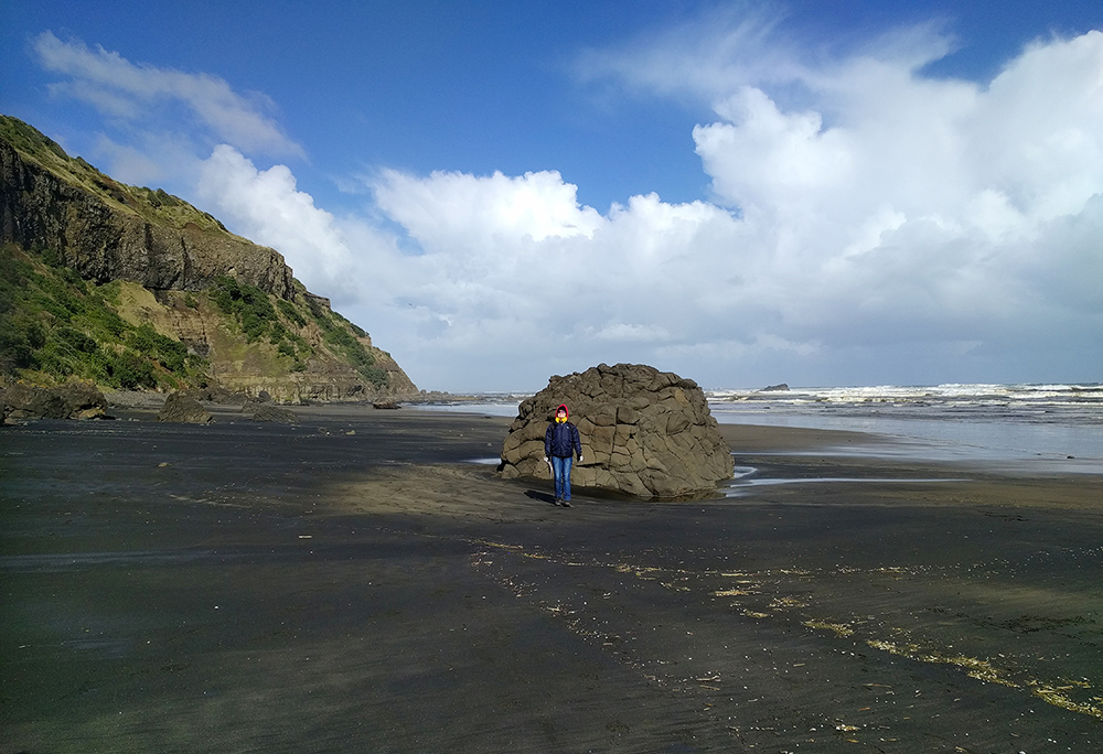 Day 6: The black volcanic sand at Muriwai Beach near the Mangere Mountain Volcano.